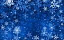 White and blue snowflakes on a dark paper background.